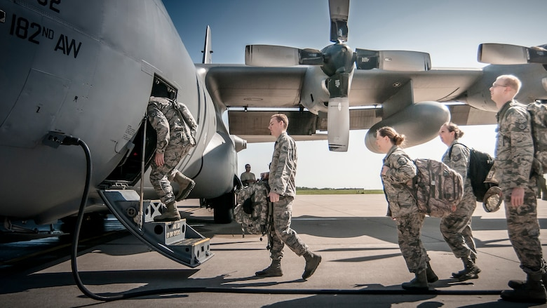 Airmen from the 168th Air Support Operations Squadron, Peoria, Ill., load into a C-130 Hercules from the 182nd Airlift Wing, Peoria, Ill., on July 17, 2015, at the 182nd Airlift Wing, Peoria, Ill., to be transported to Alpena Combat Readiness Training Center, Alpena, Michigan to participate in Exercise Northern Strike 2015. Exercise Northern Strike 2015 is a joint multi-national combined arms training exercise conducted in Michigan. (U.S. Air National Guard photo by Master Sgt. Scott Thompson/released)