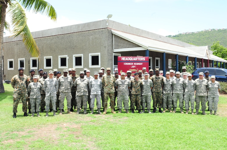 D.C. National Guard and Jamaica Defence Force 1 Engineer Regiment members pose together for a group photo on Up Camp Park Aug. 5. The 113th Civil Engineer Squadron members traveled to Jamaica as part of the State Partnership Program between the DCANG and JDF. (U.S. Air National Guard photo by Senior Airman Erica Rodriguez)