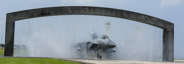 An F-15 Eagle goes through a birdbath Aug. 19, 2016, at Kadena Air Base, Japan. The birdbath is a vital component of maintaining the longevity of Kadena's fighter aircraft. The birdbath prevents corrosion from building up on the aircraft. (U.S. Air Force photo by Airman 1st Class Lynette M. Rolen)