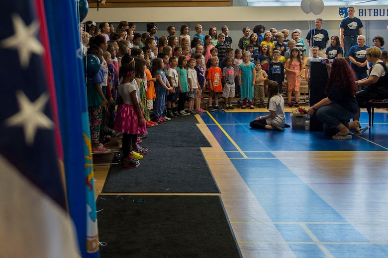Bitburg Elementary School students sing in an assembly for the last day of the school's operations at Bitburg Annex, Germany, June 10, 2016. The 2016-2017 school year will be the first to feature a single elementary school for 52nd Fighter Wing students at Spangdahlem Air Base, Germany. (U.S. Air Force photo by Senior Airman Luke Kitterman/Released)