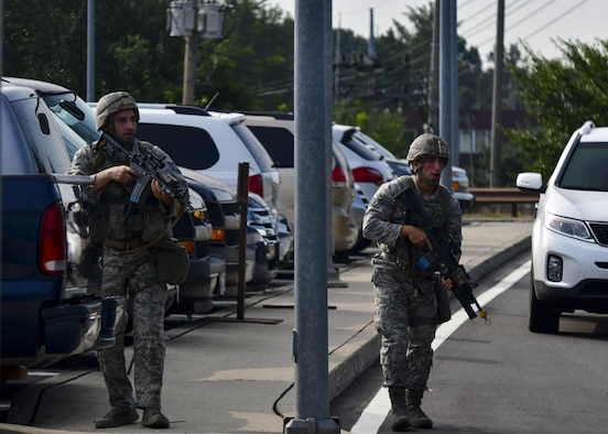 Defenders from the 51st Security Forces Squadron respond to gunfire from opposition forces during Exercise Beverly Herd 16-2 at Osan Air Base, Republic of Korea, Aug. 24, 2016. Defenders were deployed around Bldg. 1097 after reports of hostile forces were called in, swiftly backing up the personnel pre-positioned at that location. (U.S. Air Force photo by Senior Airman Victor J. Caputo)