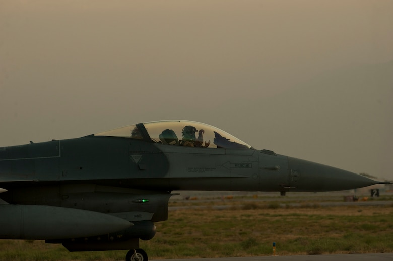 An F-16C pilot prepares to taxi down the runway prior to taking off for a mission Aug. 22, 2016, Bagram Airfield, Afghanistan. The F-16s based out of Bagram, are the only dedicated fighter squadron in the country and continuously supports Operation Freedom's Sentinel and the NATO Resolute Support mission. (U.S. Air Force photo by Capt. Korey Fratini)