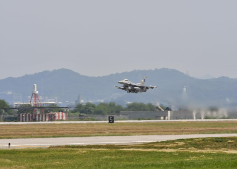 An F-16 Fighting Falcon, assigned to the 36th Fighter Squadron, takes off for a sortie in support of Exercise Beverly Herd 16-2 at Osan Air Base, Republic of Korea, Aug. 24, 2016. The 36th and 25th Fighter Squadrons launched multiple sorties in a short span of time during the exercise, simulating the quick turnaround time required in a wartime environment. (U.S. Air Force photo by Senior Airman Victor J. Caputo)