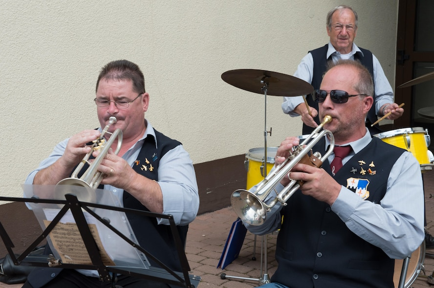 Members of the 52nd Fighter Wing Base Brass Band, Erich Kremer, left front, and Thomas Pitsch, right front, play trumpets, while Herbert Lehnertz beats a set of drums during a musical performance at Multicultural Awareness Day Aug. 18, 2016, at Club Eifel, Spangdahlem Air Base, Germany. Multicultural Awareness Day provided Spangdahlem members and their families a variety of free, culturally-diverse entertainment including a band, singing, dancing and a fashion show. (U.S. Air Force photo by Tech. Sgt. Amanda Currier)