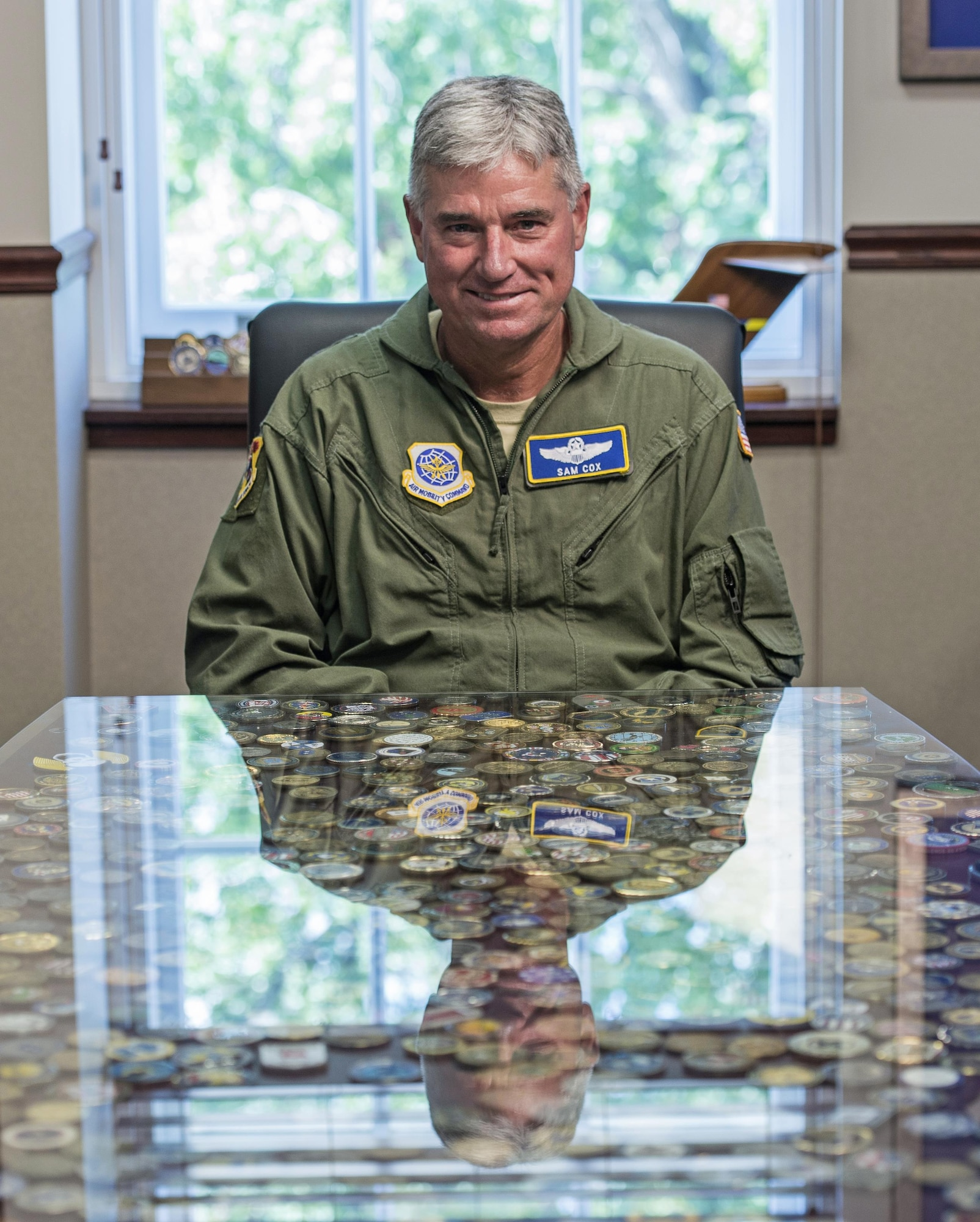 """Lt. Gen. Sam Cox, the 18th Air Force commander, was invited to sit on the Army Airborne Board, a newly formed group that oversees Army airborne operations. Ongoing work by the Air Force and Army has filled training schedules by streamlining the Joint Airborne/Air Transportability Training program, an online system used by military units to request air support. """"The chute count is higher now than it was a year ago, and we're going to continue to build on that,"""" Cox said. (U.S. Air Force photo/Master Sgt. Brian Ferguson)"""
