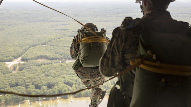 Marines with 4th Reconnaissance Battalion, 4th Marine Division, Marine Forces Reserve, jump from the back of a C-130 during Exercise Northern Strike 2016 at Camp Grayling Joint Maneuver Training Center, Mich., Aug. 17, 2016. The Marines demonstrated their skills and kept their qualifications up to date.  Exercise Northern Strike 16 is a National Guard Bureau-sponsored exercise uniting approximately 5,000 Army, Air Force, Marine, and Special Forces service members from 20 states and three coalition countries. The exercise strives to provide accessible, readiness-building opportunities for military units from all service branches to achieve and sustain proficiency in conducting mission command, air, sea, and ground maneuver integration, and the synchronization of fires in a joint, multinational, decisive action environment.
