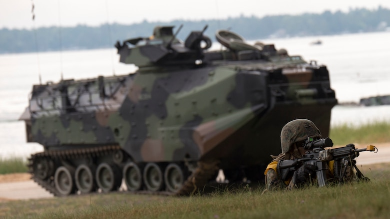 A Marine with 4th Assault Amphibian Battalion, 4th Marine Division, Marine Forces Reserve, provides security for his amphibious assault vehicle at Camp Grayling Joint Maneuver Training Center, Mich., Aug. 17, 2016. The exercise also included infantry training techniques and military operations in urban terrain.  Exercise Northern Strike Northern Strike 16 is a National Guard Bureau-sponsored exercise uniting approximately 5,000 Army, Air Force, Marine, and Special Forces service members from 20 states and three coalition countries. The exercise strives to provide accessible, readiness-building opportunities for military units from all service branches to achieve and sustain proficiency in conducting mission command, air, sea, and ground maneuver integration, and the synchronization of fires in a joint, multinational, decisive action environment.