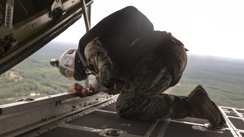 Sgt. Juan Gonzalez, paraloft chief for Company C, 4th Reconnaissance Battalion, Marine Forces Reserve, checks the distance left before a jump during Exercise Northern Strike 2016 at Camp Grayling Joint Maneuver Training Center, Mich., Aug. 16, 2016. Reserve Recon Marines practice jumping from the back of C-130s to meet their requirements and perfect their skills.  Exercise Northern Strike 16 is a National Guard Bureau-sponsored exercise uniting approximately 5,000 Army, Air Force, Marine, and Special Forces service members from 20 states and three coalition countries. The exercise strives to provide accessible, readiness-building opportunities for military units from all service branches to achieve and sustain proficiency in conducting mission command, air, sea, and ground maneuver integration, and the synchronization of fires in a joint, multinational, decisive action environment.