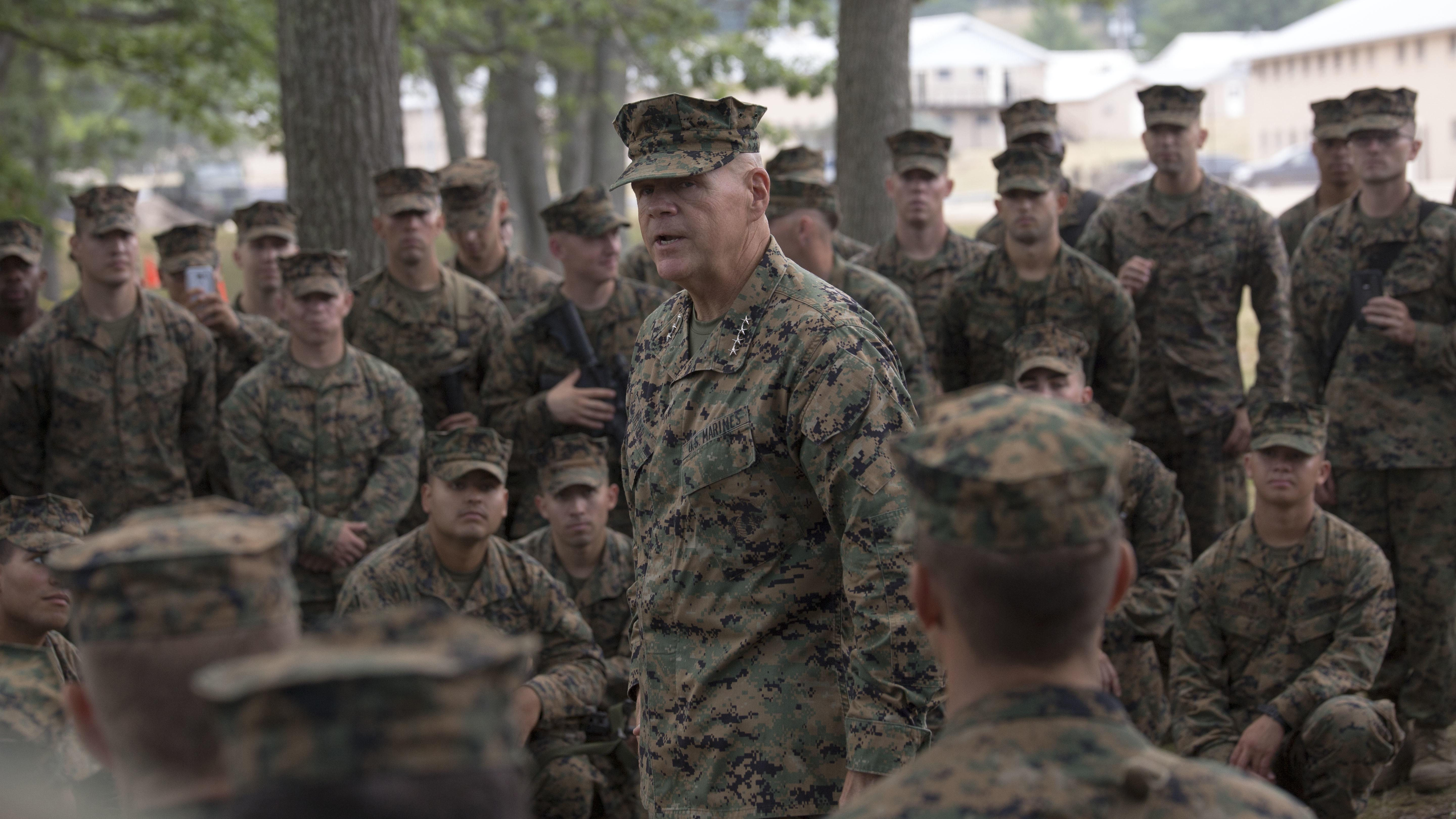 Marine Corps Commandant Gen. Robert Neller addresses Marines wearing the woodland MARPAT cammie uniform. (Photo from U.S. Marine Corps)