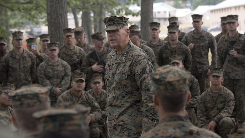 Gen. Robert B. Neller, Commandant of the Marine Corps, speaks with a group of Marines from Marine Forces Reserve about the importance of their training during Exercise Northern Strike 2016 at Camp Grayling Joint Maneuver Training Center, Mich., Aug. 17, 2016. The CMC visited exercise Northern Strike to observe the Marines and their training.  Exercise Northern Strike Northern Strike 16 is a National Guard Bureau-sponsored exercise uniting approximately 5,000 Army, Air Force, Marine, and Special Forces service members from 20 states and three coalition countries. The exercise strives to provide accessible, readiness-building opportunities for military units from all service branches to achieve and sustain proficiency in conducting mission command, air, sea, and ground maneuver integration, and the synchronization of fires in a joint, multinational, decisive action environment.