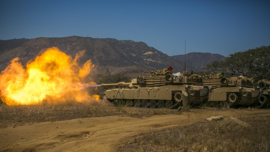 Marines with Company A, 4th Tank Battalion, 4th Marine Division, Marine Forces Reserve, fire a M1A1 Abrams Main Battle Tank during their annual training at Marine Corps Base Camp Pendleton, Calif., July 19, 2016. Marines fired the tanks to adjust their battle sight zero before the main event of their annual training.