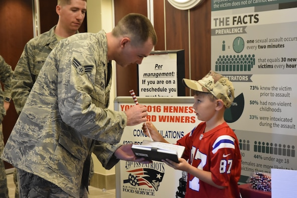 "Ten-year old Jeffrey from Agawam, Mass. shakes hands and obtains the autographs of more than 200 Airmen during lunch hour at the Westover Consolidated Club on August 7, 2016. Jeffrey is on a mission to see how many veterans he can thank before Veteran's Day this year. Jeffrey was coined by members from several squadrons at Westover, including the 439th Civil Engineering Squadron ""dirt boys."""