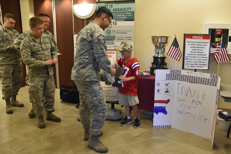 Ten-year old Jeffrey from Agawam, Mass. shakes hands and obtains the autographs of more than 200 Airmen during lunch hour at the Westover Consolidated Club on August 7, 2016. Jeffrey is on a mission to see how many veterans he can thank before Veteran's Day this year.