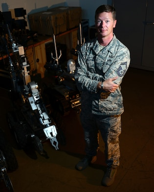 U.S. Air Force Senior Master Sgt. Michael Becker, the explosive ordnance disposal (EOD) flight chief assigned to the 509th Civil Engineer Squadron, poses next to a F6A robot at Whiteman Air Force Base, Mo., Aug. 22, 2016. Becker is the Air Force recipient of the 2016 Jewish Institute for National Security Affairs Grateful Nation Award for his superior conduct in the war on terrorism and designing new state-of-the-art robotics systems to keep Airmen safe inside assault vehicles during missions. (U.S. Air Force photo by Senior Airman Danielle Quilla)