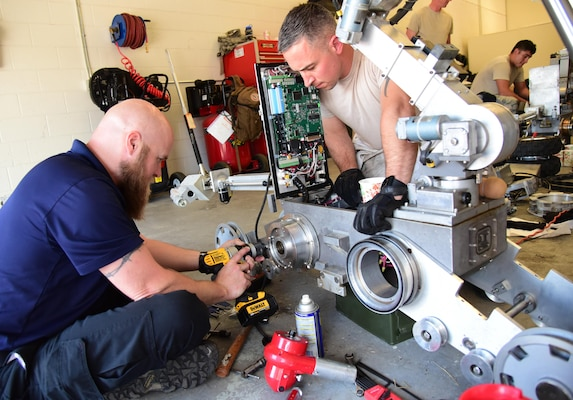 Technical Sgt. Dustin Frey, 140th Wing Civil Engineer Squadron explosive ordnance disposal technician, assists Jack Caylor, Northrop Grumman Remotec robotic instructor, remove a difficult component during a maintenance class at Peterson Air Force Base, Colo., Aug. 17, 2016. The 21st Civil Engineer Squadron EOD shop hosted the 140th Wing CES EOD out of Buckley Air Force Base, Colo., the 302nd Airlift Wing CES EOD at Peterson AFB, Colo., and the El Paso County bomb squad for an advanced maintenance course held here August 15-19. (U.S. Air Force photo by Staff Sgt. Amber Grimm)
