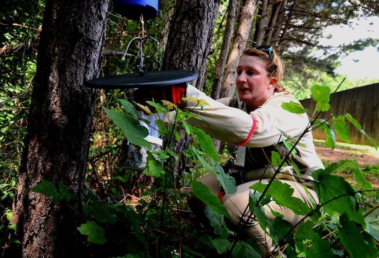 Kathleen Schmidt, Georgia Department of Public Health vector surveillance coordinator, lays traps at the firing range at Dobbins Air Reserve Base, Ga., on June 24, 2016. Schmidt came to Dobbins as part of a Department of Defense intiative to help comabt the Zika virus. (U.S. Air Force photo by Staff Sgt. Daniel Phelps)