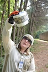 Kathleen Schmidt, from the State of Georgia Public Health Department, examines a mosquito trap to be sent for testing of the zika virus, on Dobbins Air Reserve Base, Ga., on June 24, 2016. The traps were placed in close proximity to where recent bites were experienced by base personnel (U.S. Air Force photos/Don Peek)