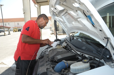 Matthew Callender, 502nd Logistic Readiness Squadron motor vehicle operator, checks the oil level of a van Aug. 12 at JBSA-Randolph. The 502nd LRS vehicle operations consists of 198 active-duty members, Department of Defense civilians and contractors who help serve 266 mission partners throughout JBSA. The department has 350 vehicles in its inventory, including buses, sedans, vans, trucks, tractor-trailers, wrecker recovery vehicles and forklifts.