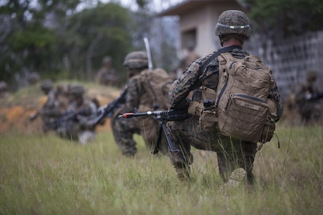 U.S. Marine Corps Lance Cpl. Taylor Abbot (right), rifleman, Company E, Battalion Landing Team 2nd Battalion, 4th Marines, (BLT) 31st Marine Expeditionary Unit provides security while conducting a Helo Raid at Combat Town, Okinawa, Japan, Dec. 8, 2014. Company E is conducting training as part of the MEU Exercise and pre-deployment training. (U.S. Marine Corps Photo by Lance Cpl. Richard Currier/ Released)