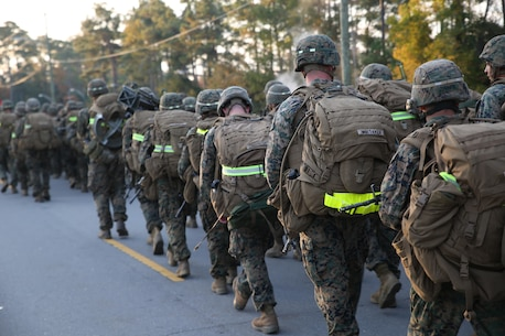 Marines with the Ground Combat Element Integrated Task Force conduct a combat conditioning hike aboard Marine Corps Base Camp Lejeune, North Carolina, Nov. 21, 2014. The task force hiked approximately 10-kilometers. The Marines carried a varied array of weapons; from standard M16A4 and M4 service rifles, to M240B machine guns, Mk-153 shoulder-launched multipurpose assault weapons and 60mm mortar systems, in addition to an assault fighting load. From October 2014 to July 2015, the Ground Combat Element Integrated Task Force will conduct individual and collective skills training in designated combat arms occupational specialties in order to facilitate the standards based assessment of the physical performance of Marines in a simulated operating environment performing specific ground combat arms tasks. (U.S. Marine Corps photo by Cpl. Paul S. Martinez/Released)