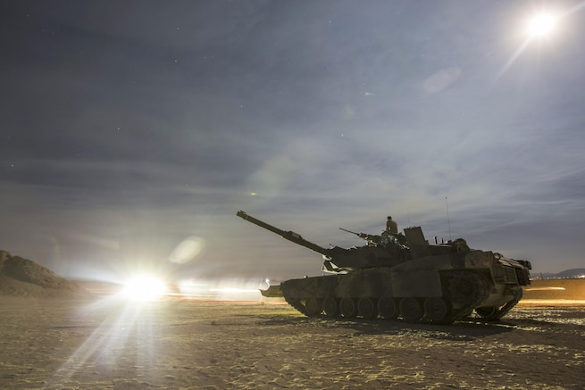 A Marine Corps M1A1 tank conducts tactical training during Large Scale Exercise 2016 at Marine Corps Air Ground Combat Center Twentynine Palms, Calif., Aug. 16, 2016. The goal of the exercise is to enhance interoperability among thousands of Marines. Marine Corps photo by Cpl. Clarence A. Leake