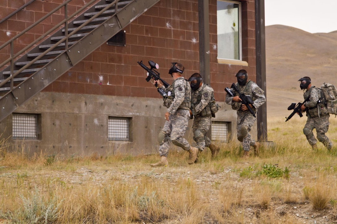 The 2016 U.S. Army Reserve Best Warrior winners and runner-ups navigate an urban terrain site during training at Fort Harrison, Mont., August 5, 2016. The USAR BWC winners from the noncommissioned officer and Soldier category are going through rigorous training, leading up to their appearance at Fort A.P. Hill later this year for the Department of Army BWC. (U.S. Army Reserve photo by  Brian Godette, USARC Public Affairs)