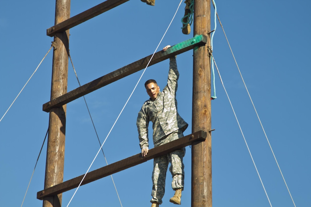 Sgt. 1st Class Joshua A. Moeller, U.S. Army Reserve Best Warrior Competition noncommissioned officer winner, navigates a section of the obstacle course during  training at Fort Harrison, Mont., August 5, 2016. The USAR BWC winners from the NCO and Soldier category are going through rigorous training, leading up to their appearance at Fort A.P. Hill later this year for the Department of Army BWC. (U.S. Army Reserve photo by  Brian Godette, USARC Public Affairs)