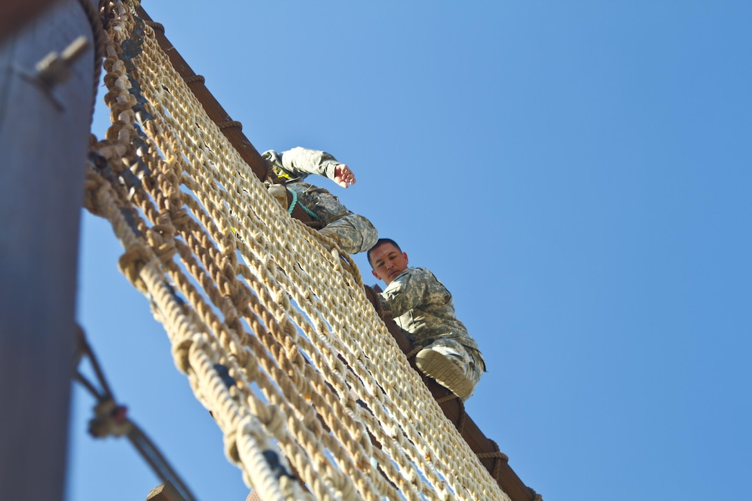 Spc. Michael S. Orozco, U.S. Army Reserve Best Warrior Competition winner in the Soldier category, navigates a section of the obstacle course during  training at Fort Harrison, Mont., August 5, 2016. The USAR BWC winners from the NCO and Soldier category are going through rigorous training, leading up to their appearance at Fort A.P. Hill later this year for the Department of Army BWC. (U.S. Army Reserve photo by  Brian Godette, USARC Public Affairs)(U.S. Army Reserve photo by  Brian Godette, USARC Public Affairs)