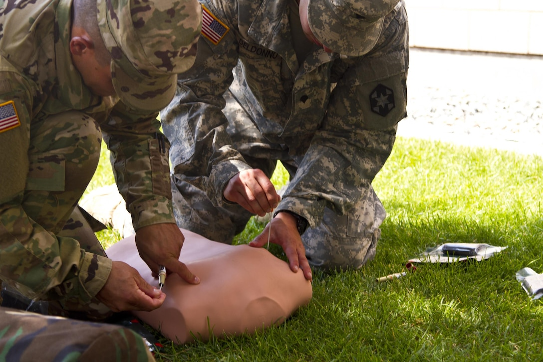 The 2016 U.S. Army Reserve Best Warrior winner from the Soldier category, Spc. Michael S. Orozco, and runner-up, Spc. Carlo Deldonno, treat a medical casualty during simulated training at Fort Harrison, Mont., August 5, 2016. The USAR BWC winners from the noncommissioned officer and Soldier category are going through rigorous training, leading up to their appearance at Fort A.P. Hill later this year for the Department of Army BWC. (U.S. Army Reserve photo by  Brian Godette, USARC Public Affairs)
