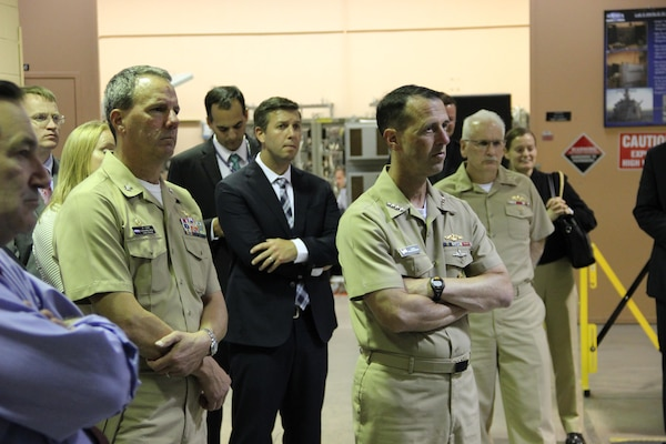 Chief of Naval Operations (CNO) Adm. John Richardson received briefings about Naval Surface Warfare Center Crane Division's three mission focus areas, Expeditionary Warfare, Strategic Missions and Electronic Warfare.