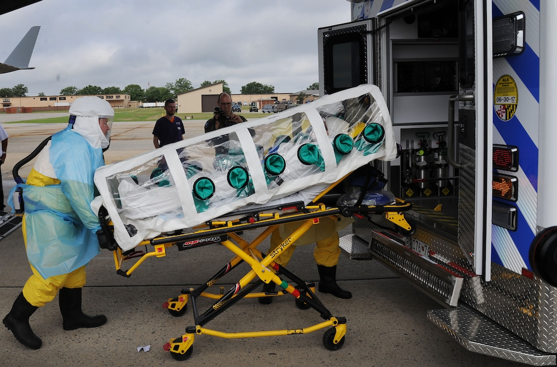 The Air Force District of Washington AFMS 79th Medical Wing and other military medical personnel assigned to Walter Reed National Military Medical Center transfers a simulated patient for further care at WRNMMC during the 2016 Mobility Solace Exercise, exercising the ability of military medics to safely transport patients with High Consequence Infectious Diseases, such as Ebola. The patient traveled to Joint Base Andrews from Joint Base Charleston via an Air Mobility Command 