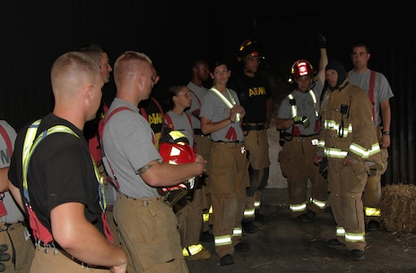 FORT MCCOY, Wis. – U.S. Army Reserve firefighters discuss fire scenarios in the burn tower on Fort McCoy, Wis., Aug. 21, 2016. A total of five units from Wisconsin, Illinois and South Dakota participated in the training. The units trained to put out a fire and also search and rescue.  (U.S. Army Reserve Photo by Sgt. Quentin Johnson, 211th Mobile Public Affairs Detachment/Released)