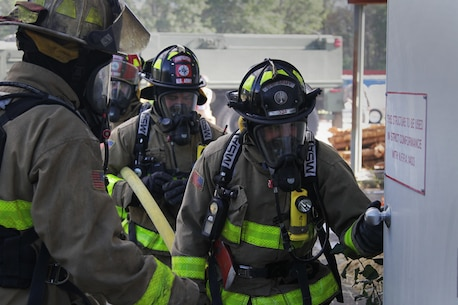 FORT MCCOY, Wis. – U.S. Army Reserve firefighters from the 237th Firefighter Detachment, Sturtevant, Wis., prepare to enter the burn house to put out a fire during an exercise at Fort McCoy, Aug. 21, 2016. The training helped firefighters find weaknesses in their techniques, while learning new ones. (U.S. Army Reserve Photo by Sgt. Quentin Johnson, 211th Mobile Public Affairs Detachment/Released)