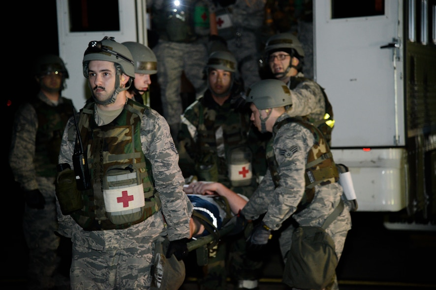 U.S. Air Force Staff Sgt. Nicholas Grant, 51st Aerospace Medicine Squadron medical technician, and Airmen from the 51st AMDS transport a simulated injured service member to a C-130 Hercules during a medical evacuation scenario for Exercise Beverly Herd 16-2 at Osan Air Base, Republic of Korea, Aug. 25, 2016. In the event of a mass casualty incident, the 51st AMDS plays a critical role in the survivability of the patients, and its personnel train to ensure this need is met.  (U.S. Air Force photo by Senior Airman Dillian Bamman)