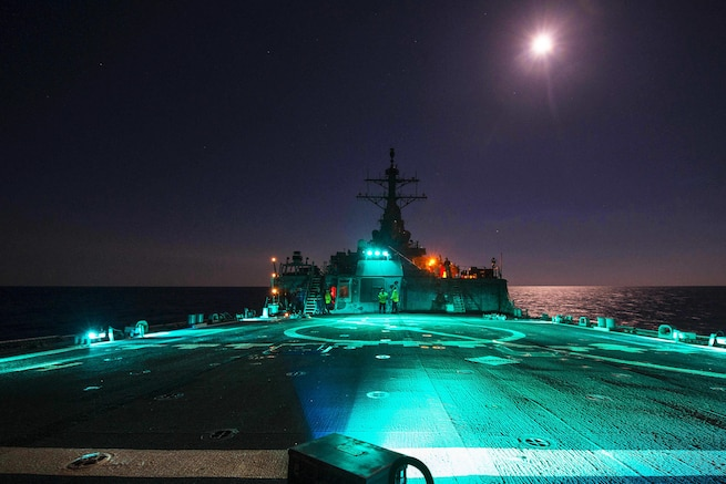 Navy crews conduct flight operations on the flight deck of the USS Carney in the Mediterranean Sea, Aug. 17, 2016. The Carney is patrolling in the U.S. 6th Fleet area of responsibility to support U.S. national security interests in Europe. Navy photo by Petty Officer 3rd Class Weston Jones