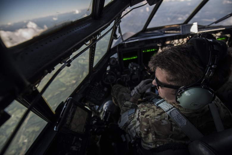 A pilot  with the 15th Special Operations Squadron scans the ground during routine low-level flying training during Task Force Exercise Olympus Archer at Wright Patterson Air Force Base, Ohio, Aug. 21, 2016. Olympus Archers' focus is to maximize training opportunities for more than 230 Air Commandos with the 1st Special Operations Wing with an emphasis on medical operations in conjunction with flying operations. (U.S. Air Force photo by Staff Sgt. Christopher Callaway)