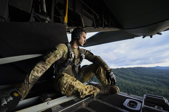 Tech. Sgt. Vince Telmanik, a loadmaster with the 15th Special Operations Squadron, sits on the ramp of an MC-130H Combat Talon II aircraft during routine low-level flying training, part of Task Force Exercise Olympus Archer at Wright Patterson Air Force Base, Ohio, Aug. 21, 2016. Olympus Archers focus is to maximize training opportunities for more than 230 Air Commandos with the 1st Special Operations Wing with an emphasis on medical operations in conjunction with flying operations. (U.S. Air Force photo by Staff Sgt. Christopher Callaway)