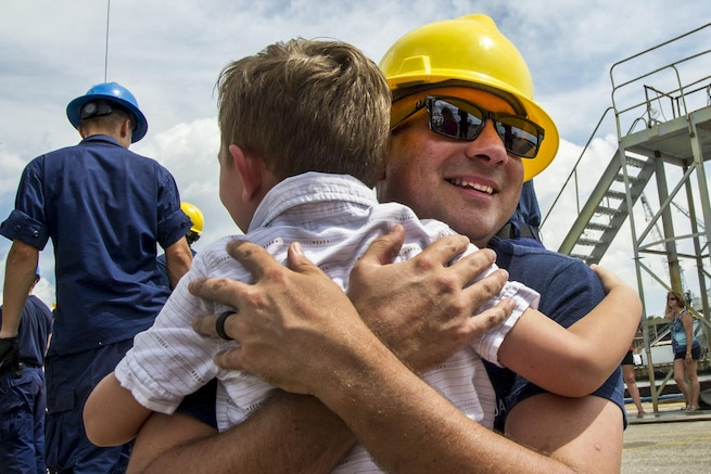Coast Guard Petty Officer 1st Class Justin Pearl reunites with his family after arriving on the Barque Eagle at the Coast Guard Yard in Baltimore, Aug. 19, 2016. The Eagle conducted port calls in Europe, Bermuda and the eastern United States. Coast Guard photo by Petty Officer 2nd Class Lisa Ferdinando
