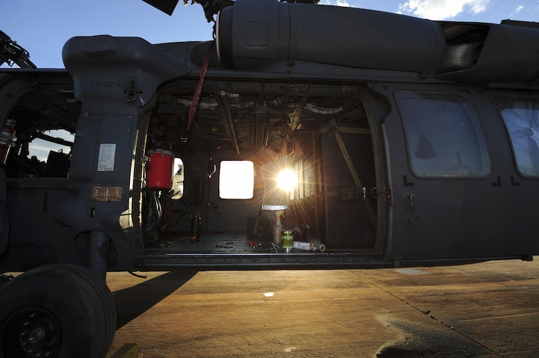 U.S. Air Force Staff Sgt. Gage, 923d Aircraft Maintenance Squadron crew chief, performs maintenance on an HH-60G Pave Hawk at Davis-Monthan Air Force Base, Ariz., Aug. 23, 2016. The 923d AMXS maintains, services and inspects HC-130J and HH-60 aircraft. (U.S. Air Force photo by Airman Nathan H. Barbour)