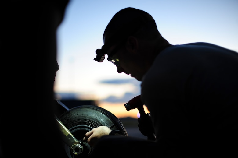 U.S. Air Force Staff Sgt. Gage, 923d Aircraft Maintenance Squadron crew chief, changes a tire on an HH-60G Pave Hawk at Davis-Monthan Air Force Base, Ariz., Aug. 23, 2016. The 923d AMXS provides direct maintenance support for the 79th Rescue Squadron, 55 RQS and 48 RQS Guardian Angels. (U.S. Air Force photo by Airman Nathan H. Barbour)