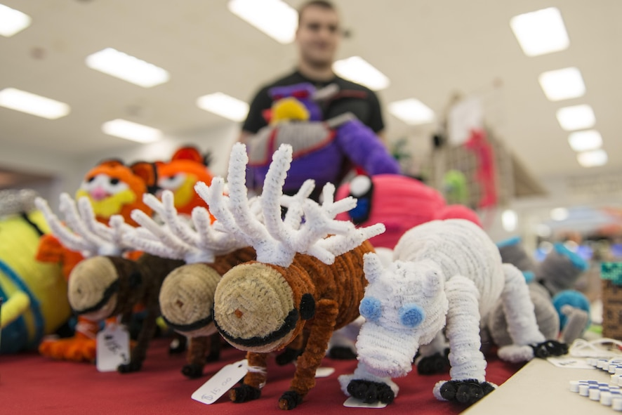 Animals made from pipe cleaners are displayed at the Base Exchange atrium April 22, 2016, at Eielson Air Force Base, Alaska. Robert Waid makes each piece of art to raise awareness about autism and show that if he can be successful with selling, anyone can. (U.S. Air Force photo by Staff Sgt. Ashley Nicole Taylor)