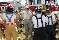 Air Force Tech. Sgt. Devon Parsons, center, gives a safety briefing to Air Force Reserve firefighters before performing a fuel burn during Exercise Patriot Warrior 2016 at the airport at Fort McCoy, Wis., Aug. 18, 2016. Parsons is an assistant chief of operations assigned to the 910th Civil Engineer Squadron. Patriot Warrior allows Air Force Reserve firefighting units from throughout the U.S. to train together and learn from professionals throughout the career field. Air Force photo by Tech. Sgt. Nathan Rivard