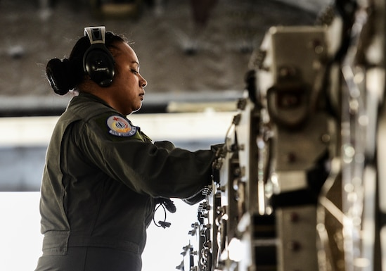 Tech. Sgt. Renee San Nicolas, 375th Aeromedical Evacuation Squadron  aeromedical evacuation technician, connects air ducts to the Transporation Isolation System to provide air in and out of the TIS. The TIS is used to transport sick and contagious patients to more definitive care without compromising the safety of the crew. (U.S. Air Force Photo by Airman Daniel Garcia)