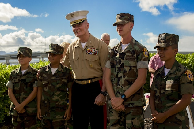 U.S. Marine Lt. Gen. John A Toolan, commander of U.S. Marine Corps Forces, Pacific, stands with members of the Pyramid Rock Young Marines program during the Marine Memorial Rededication Ceremony at the USS ARIZONA Education Center, Honolulu, Hawaii, Aug. 19, 2016.