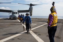 ABOARD USS GREEN BAY (LPD-20), At Sea (Aug. 22, 2016) – U.S. Navy Petty Officer 2nd Class Torien Collins, an aviation boatswain's mate, directs sailors away from a U.S. Marine Corps MV-22B Osprey tiltrotor aircraft from Marine Medium Tiltrotor Squadron 262 (reinforced), 31st Marine Expeditionary Unit, on the flight deck of the USS Green Bay (LPD-20), at sea, Aug. 22, 2016. Marines of the 31st MEU are currently embarked on ships of the USS Bonhomme Richard Expeditionary Strike Group for a regularly scheduled fall patrol of the Asia-Pacific region. The 31st MEU combines air-ground-logistics into a single unit with one commander, and is task-organized to address a range of military operations in the Asia-Pacific region, from force projection and maritime security to humanitarian assistance and disaster relief.  (U.S. Marine Corps photo by Cpl. Darien J. Bjorndal, 31st Marine Expeditionary Unit/ Released)