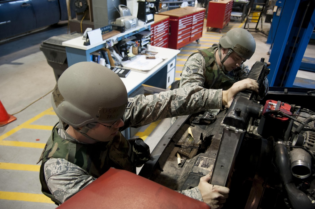 Senior Airman Thomas Harvey and Senior Airman Dillon Goulet, 51st Logistics Readiness Squadron mission generating and vehicle maintenance journeymen, remove a leaking radiator from a vehicle during Exercise Beverly Herd 16-2 on Osan Air Base, Republic of Korea, Aug. 25, 2016. Harvey and Goulet continue to enable base operations and defense of the base by fixing vehicles so they can be returned to the field. (U.S. Air Force photo by Staff Sgt. Jonathan Steffen)
