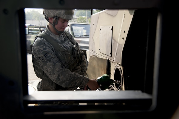 Senior Airman Samantha Erasmus, 51st Security Force Squadron heavy gunner, refuels a Humvee during Exercise Beverly Herd 16-2 on Osan Air Base, Republic of Korea, Aug. 26, 2016. Erasmus and other security forces Airmen defend the base by actively patrolling for opposition forces during the exercise. (U.S. Air Force photo by Staff Sgt. Jonathan Steffen)