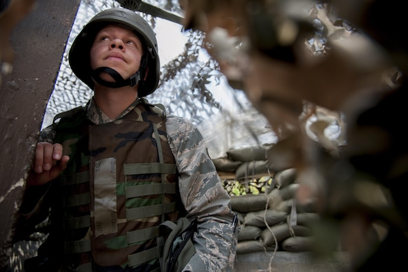 Senior Airman Darrick Marik, 51st Communications Squadron client systems technician, searches for opposing forces during a mock attack at Osan Air Base, Republic of Korea, Aug. 25, 2016. The mock attack was part of exercise Beverly Herd 16-2 and was designed test Osan's ability to defend the base. (U.S. Air Force photo by Staff Sgt. Jonathan Steffen)