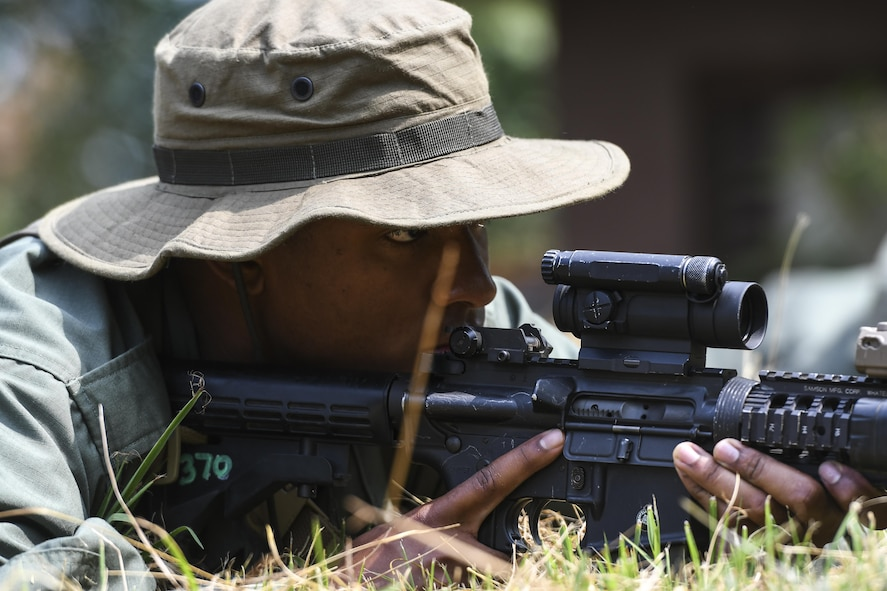 Simulated opposing forces member Airman 1st Class Jared Small stares down his sights while waiting for a truck with munitions to roll by during Exercise Beverly Herd 16-2, on Osan Air Base, Republic of Korea, Aug. 24, 2016. The OPFOR scenario was set up for U.S. armed forces to practice combat techniques. Beverly Herd provides U.S. armed for the opportunity to hone combat skills that can be used in the event of real-world contingencies. (U.S. Air Force photo by Tech. Sgt. Rasheen Douglas)