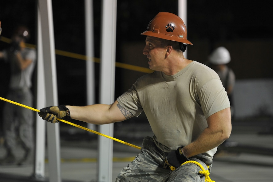 U.S. Air Force Tech. Sgt. Patrick Donahue, 49th Materiel Maintenance Squadron (MMS) structural specialist, from Holloman Air Force Base, N.M., pulls on a safety rope Aug. 7, 2016, at Incirlik Air Base, Turkey. The 49th MMS is the only active duty squadron in the Air Force that specializes in Basic Expeditionary Airfield Resources. (U.S. Air Force photo by Airman 1st Class Devin M. Rumbaugh)